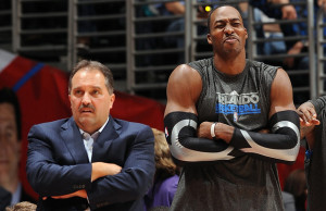 LOS ANGELES, CA - DECEMBER 12: Head Coach Stan Van Gundy and Dwight Howard #12 of the Orlando Magic react on the sideline before a game against the Los Angeles Clippers on December 12, 2010 at Staples Center in Los Angeles, California. NOTE TO USER: User expressly acknowledges and agrees that, by downloading and/or using this Photograph, user is consenting to the terms and conditions of the Getty Images License Agreement. Mandatory Copyright Notice: Copyright 2010 NBAE (Photo by Noah Graham/NBAE via Getty Images)