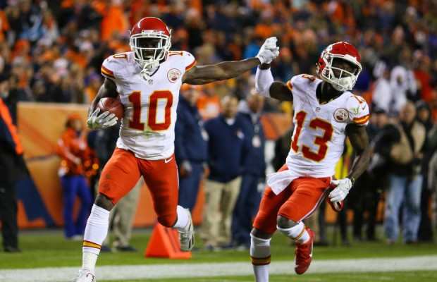DENVER, CO - NOVEMBER 27:  Wide receiver Tyreek Hill #10 of the Kansas City Chiefs celebrates with De'Anthony Thomas #13 after returning a kickoff for a touchdown in the second quarter of the game against the Denver Broncos at Sports Authority Field at Mile High on November 27, 2016 in Denver, Colorado. (Photo by Justin Edmonds/Getty Images) ORG XMIT: 663937769 ORIG FILE ID: 626200338